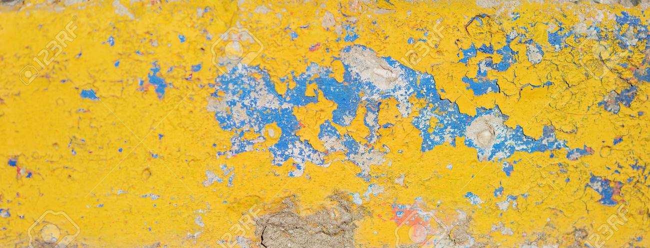 Old Cracked Wall Painted With Bright Yellow And Blue Paint. Grunge ...