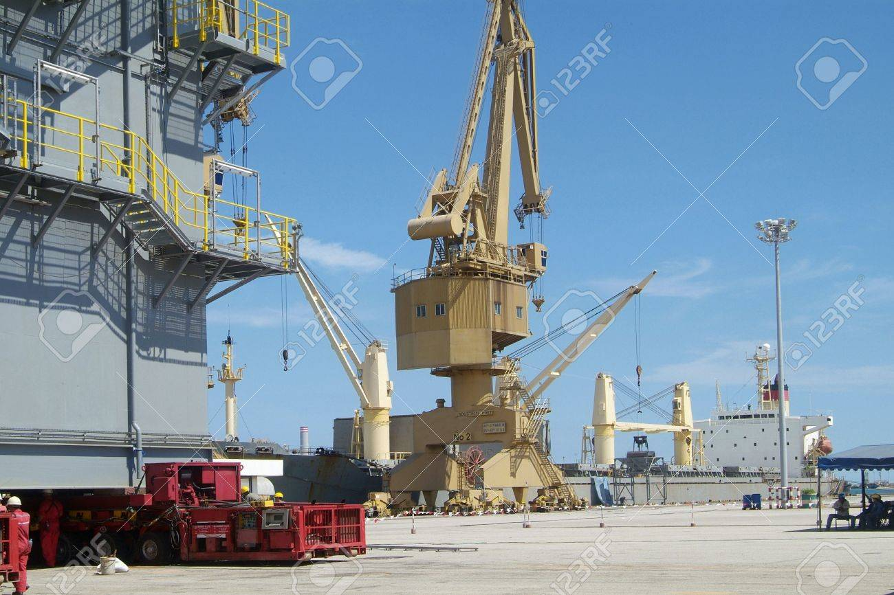Scene From Industrial Port With Freight Ship, Crane And Big Steel ...