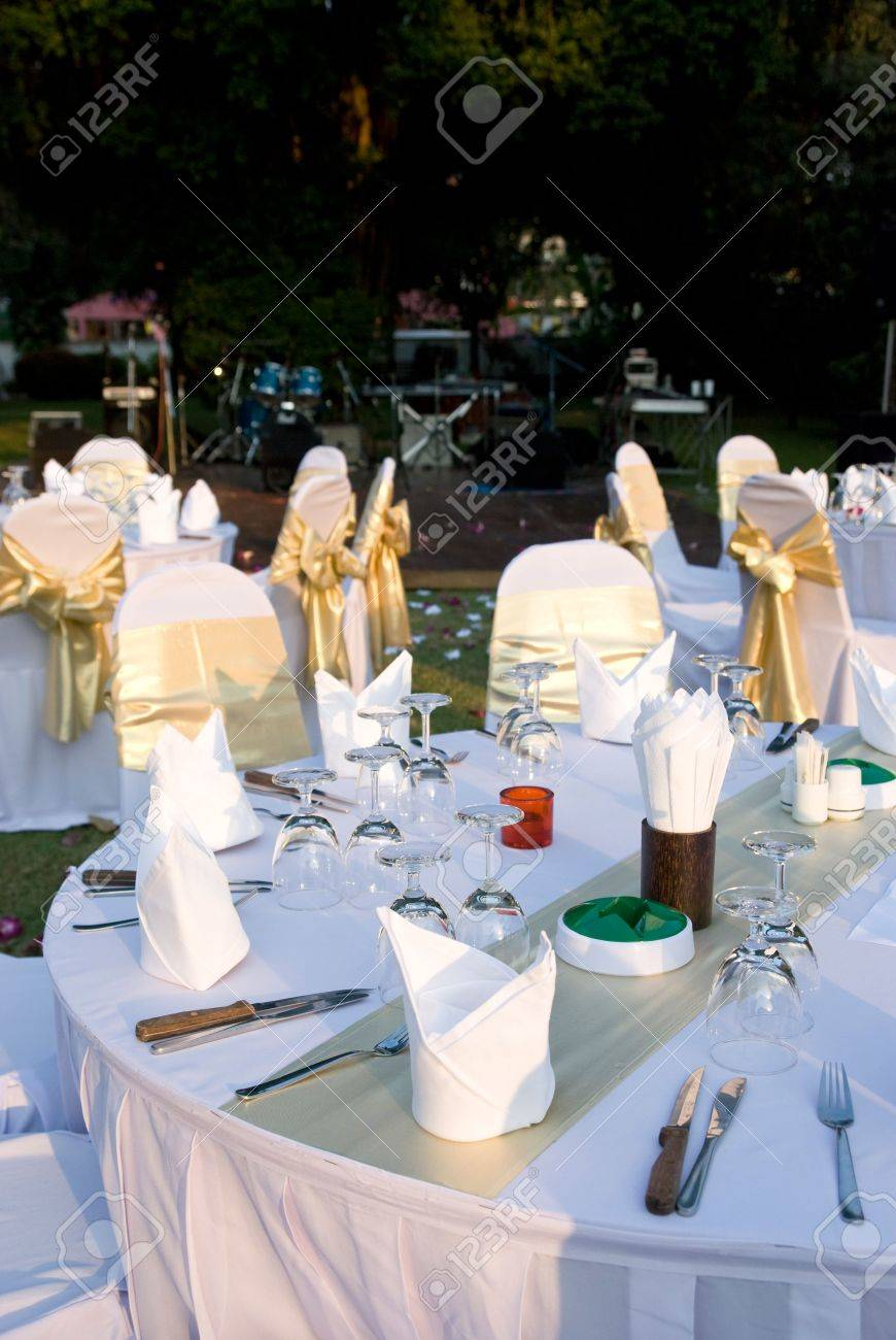 Outdoor Party Tables And Chairs With Golden Decorations Made Ready For A  Garden Party. Bandstand