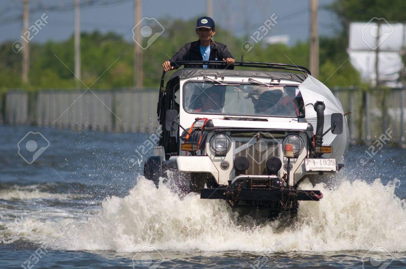 BANGKOK, THAILAND - NOVEMBER 1: Jeep navigating one of Bangkok's motorways during the worst flooding in decades in Bangkok, Thailand on November 1, 2011. Stock Photo - 11045027