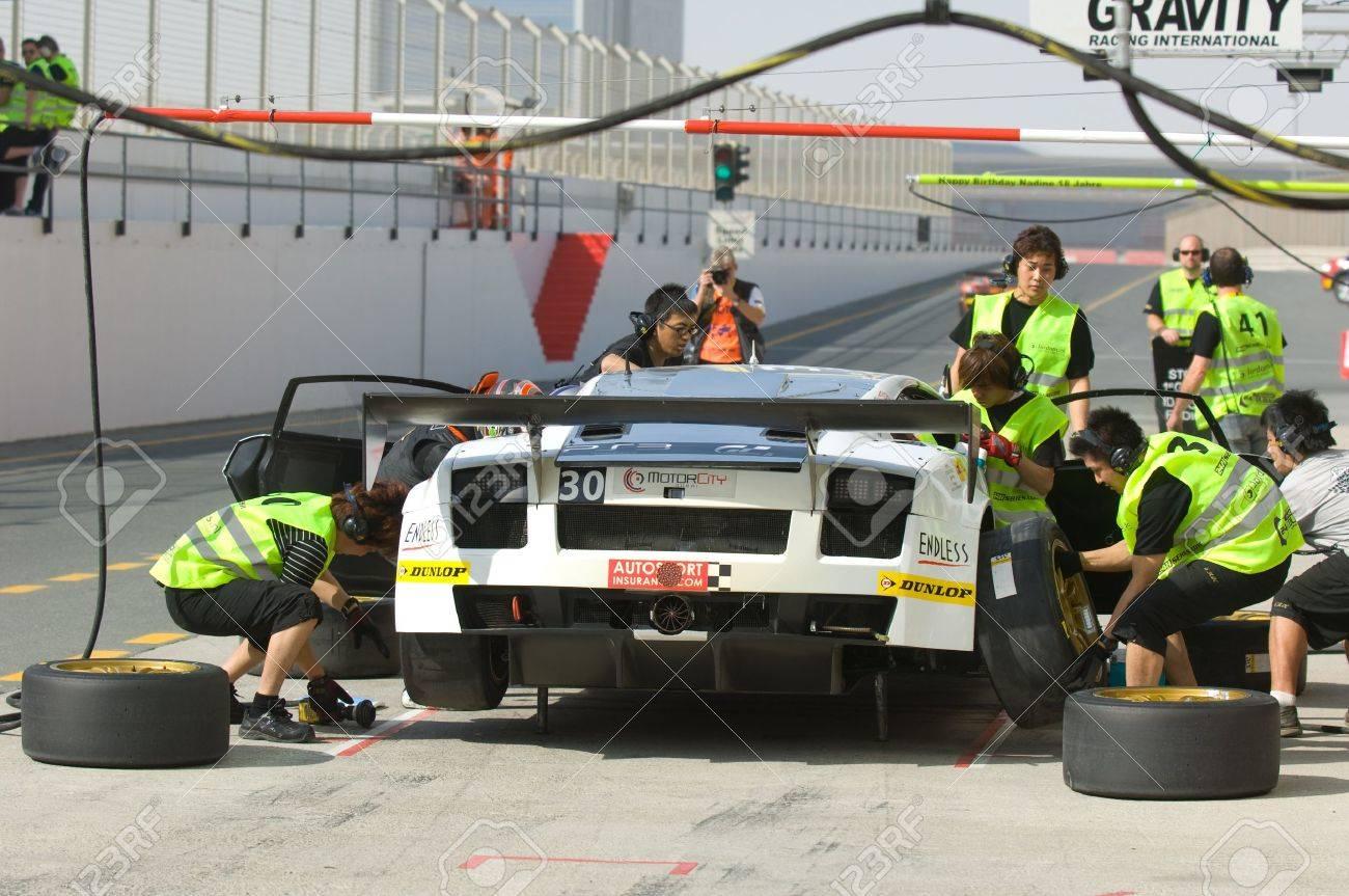 DUBAI - JANUARY 13: Car 30, a Lamborghini Gallardo LP600 during pit stop during the 2012 Dunlop 24 Hour Race at Dubai Autodrome on January 13, 2012. Stock Photo - 12060281