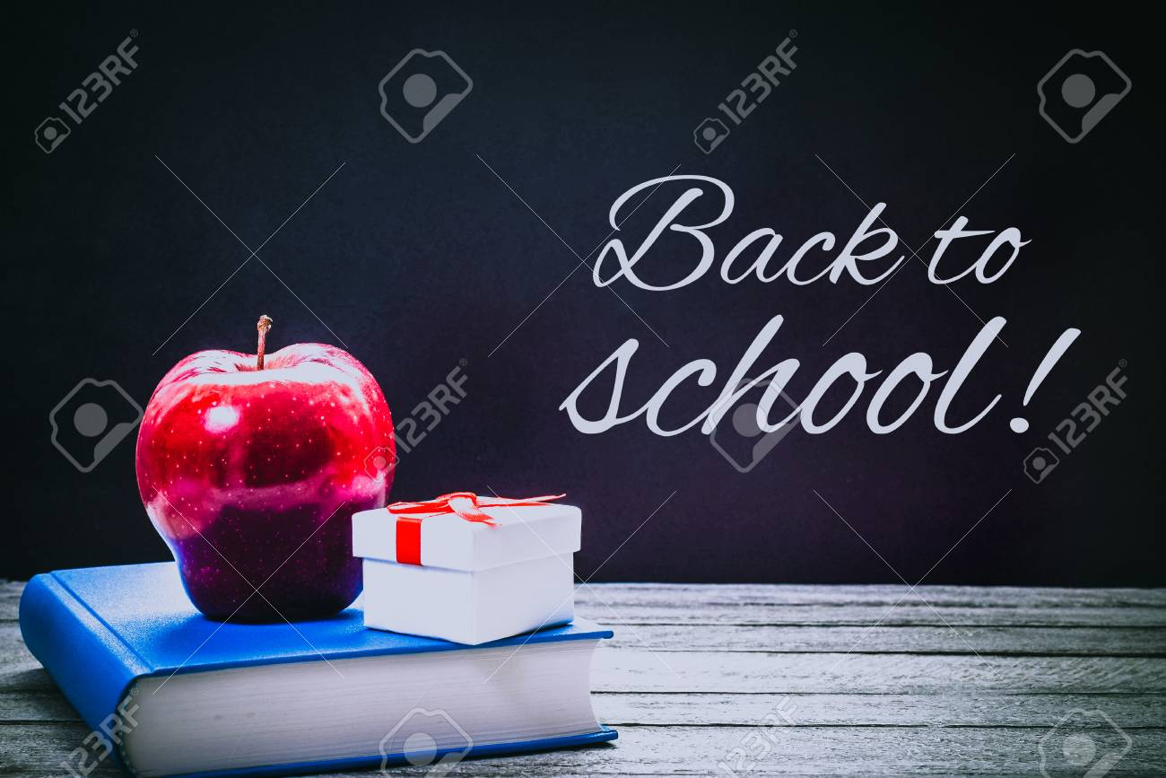 Back To School And Education Concept Book Red Apple Gift Box On Chalkboard