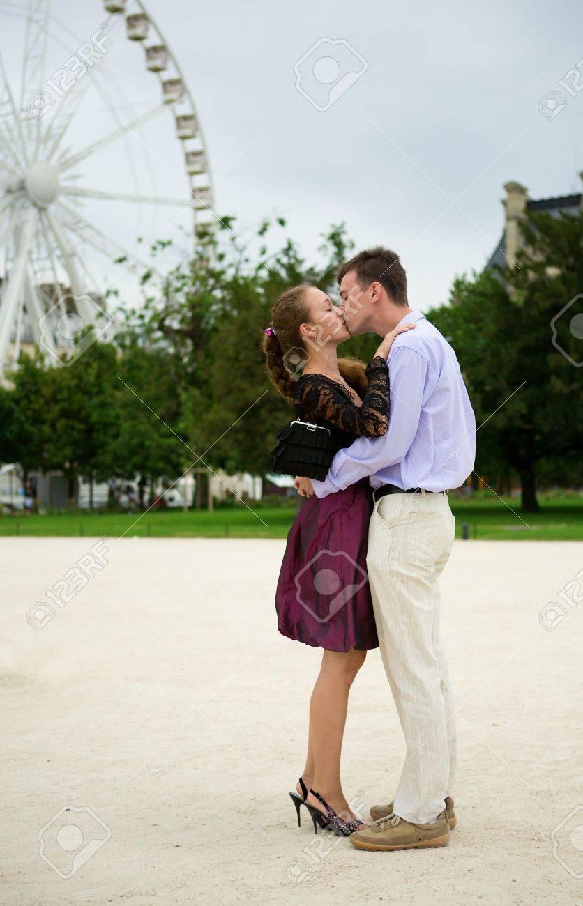 Romantic couple in Paris kissing near big dipper - 9896530