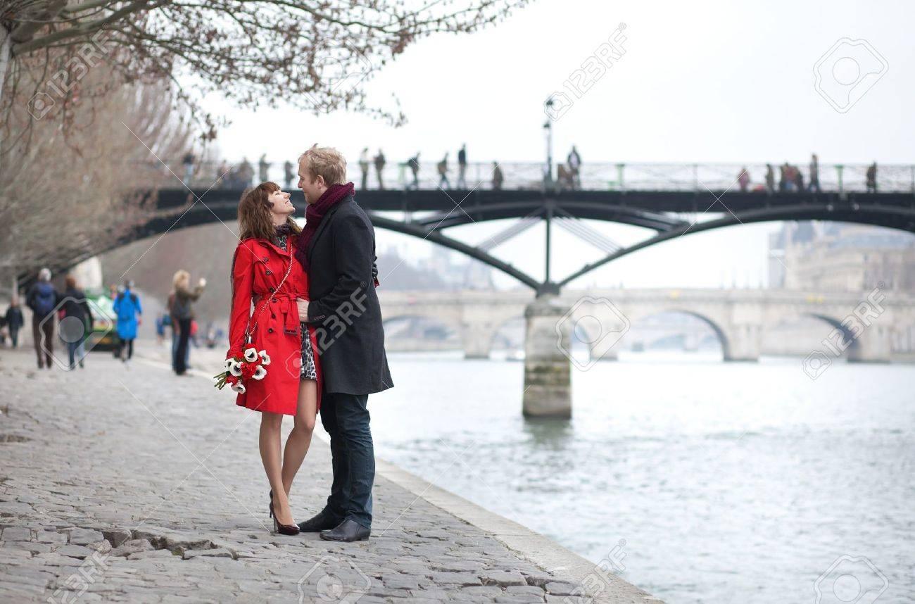 Romantic couple in love dating near Pont des Arts in Paris Stock Photo - 13104305