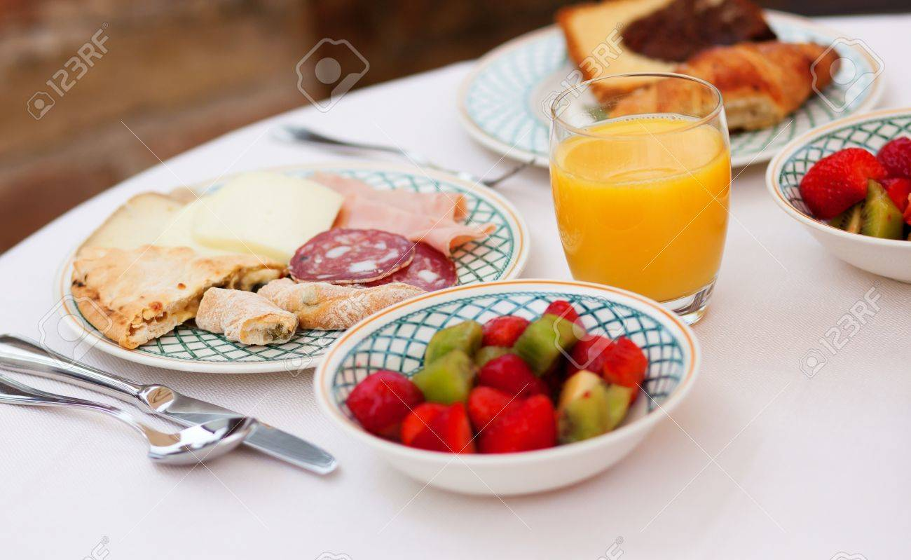 Delicious breakfast with fresh juice and fruit salad Stock Photo - 13508522