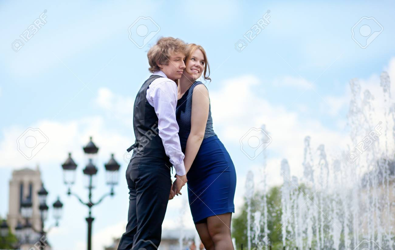 Young loving couple in Paris near beautiful fountain with view to Notre-Dame Stock Photo - 13792146