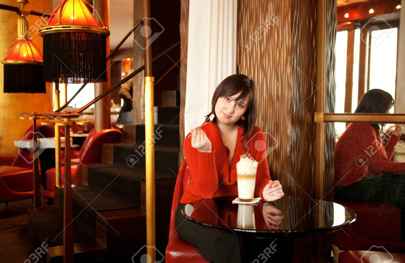 Beautiful young woman with latte in cafe Stock Photo - 14893188