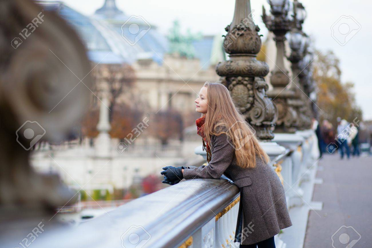 Romantic young woman with beautiful long hair on a bridge in Paris Stock Photo - 16521547