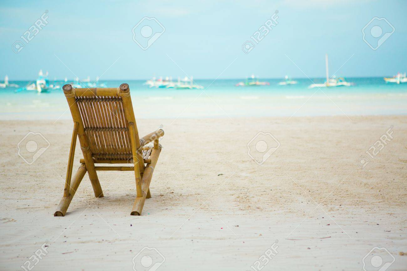 beach chair on perfect tropical white sand beach with turquoise