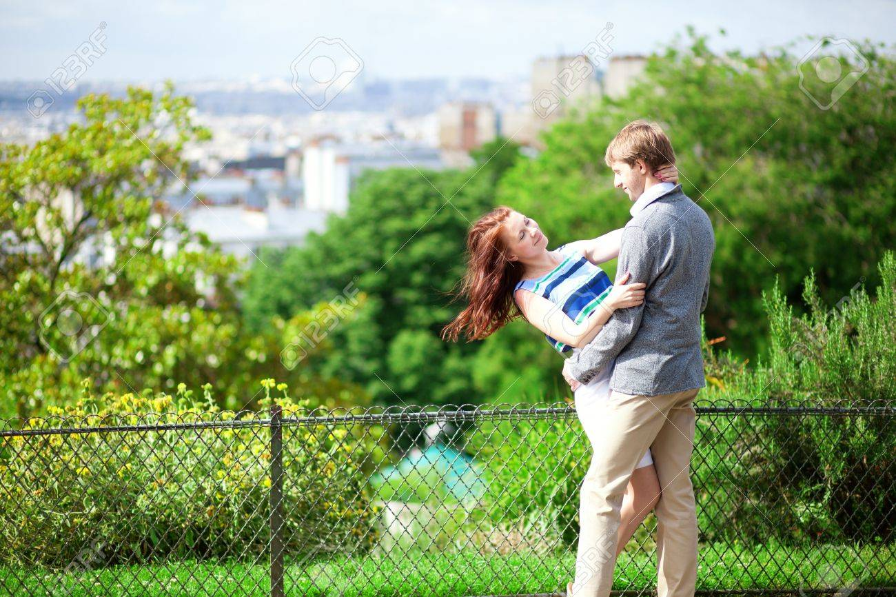 Happy couple is hugging on Montmartre with nice view on Paris Stock Photo - 17158560
