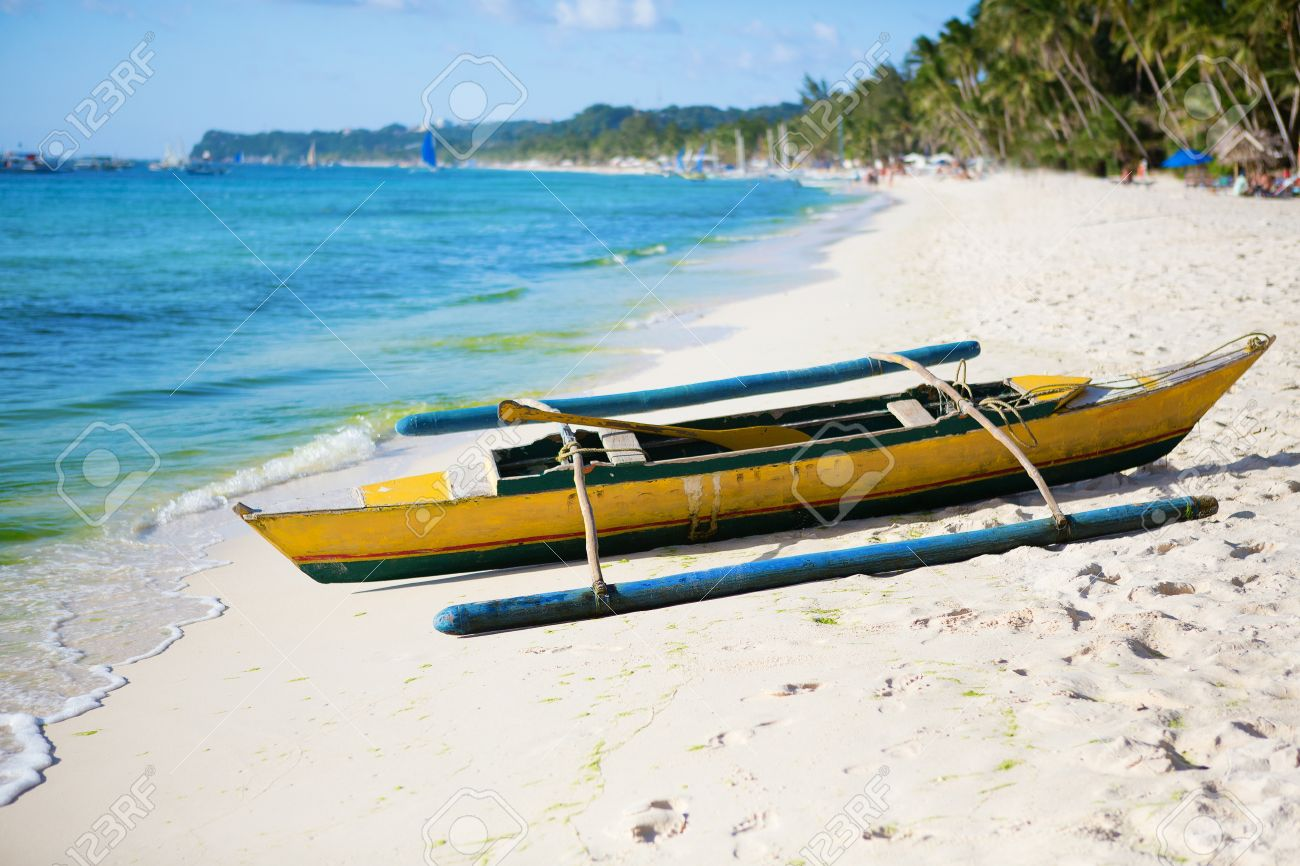old wooden bangka boat on white sand beach at boracay philippines