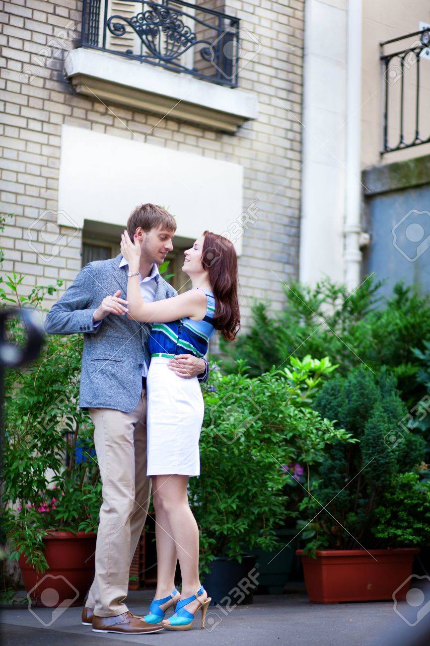 Happy positive couple hugging near their house on Montmartre in Paris Stock Photo - 17415090