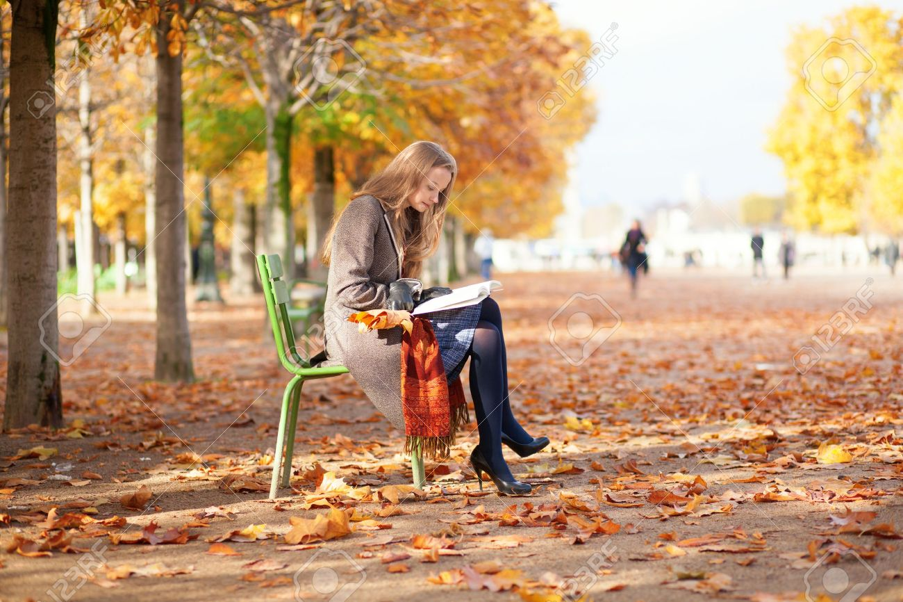 Girl reading in park on a fall day Stock Photo - 17501937