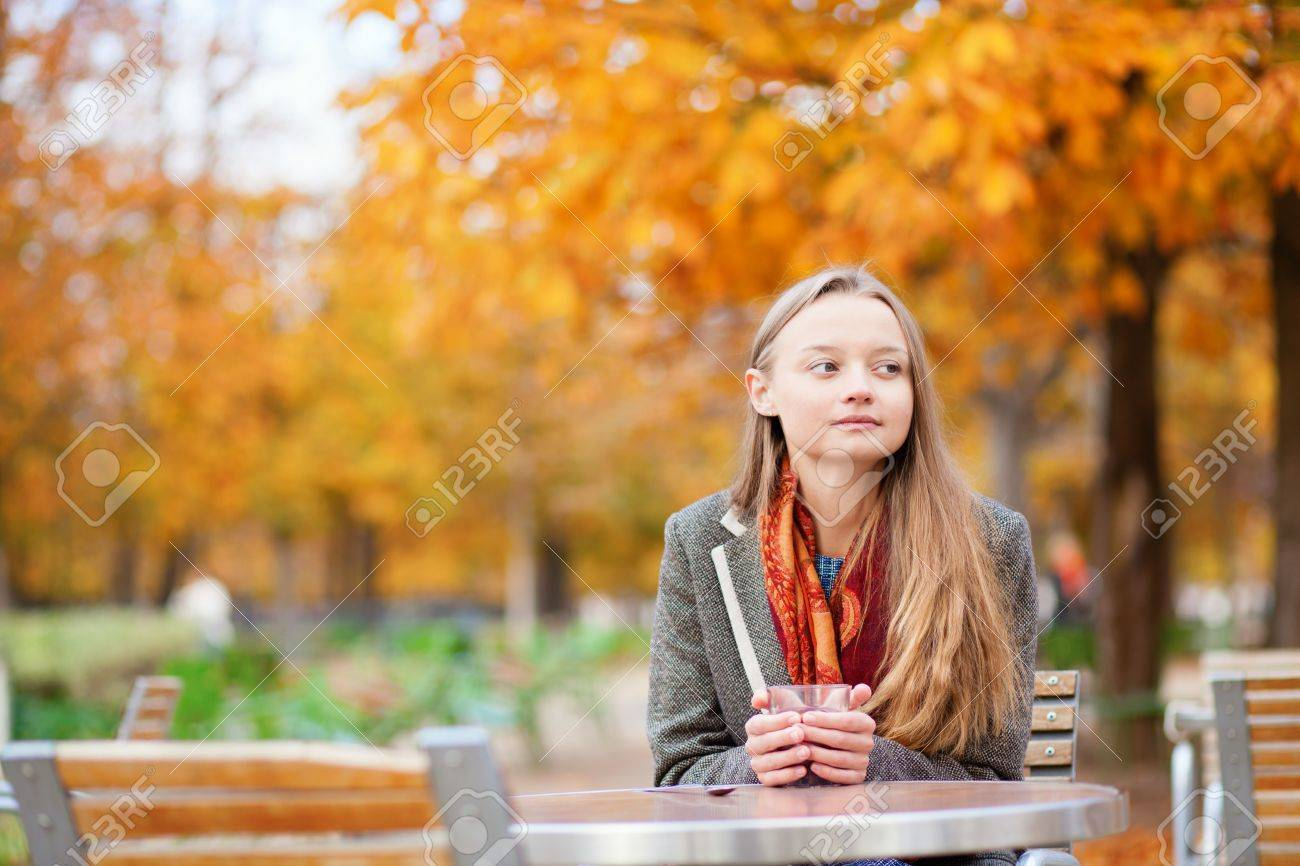 Girl drinking hot wine in a cafe Stock Photo - 18628367