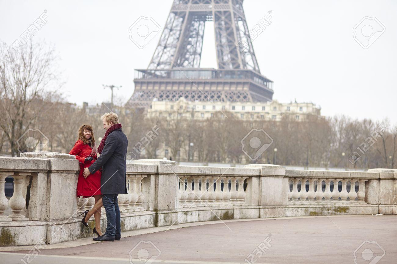 Romantic couple in love in Paris, near the Eiffel tower Stock Photo - 36228360