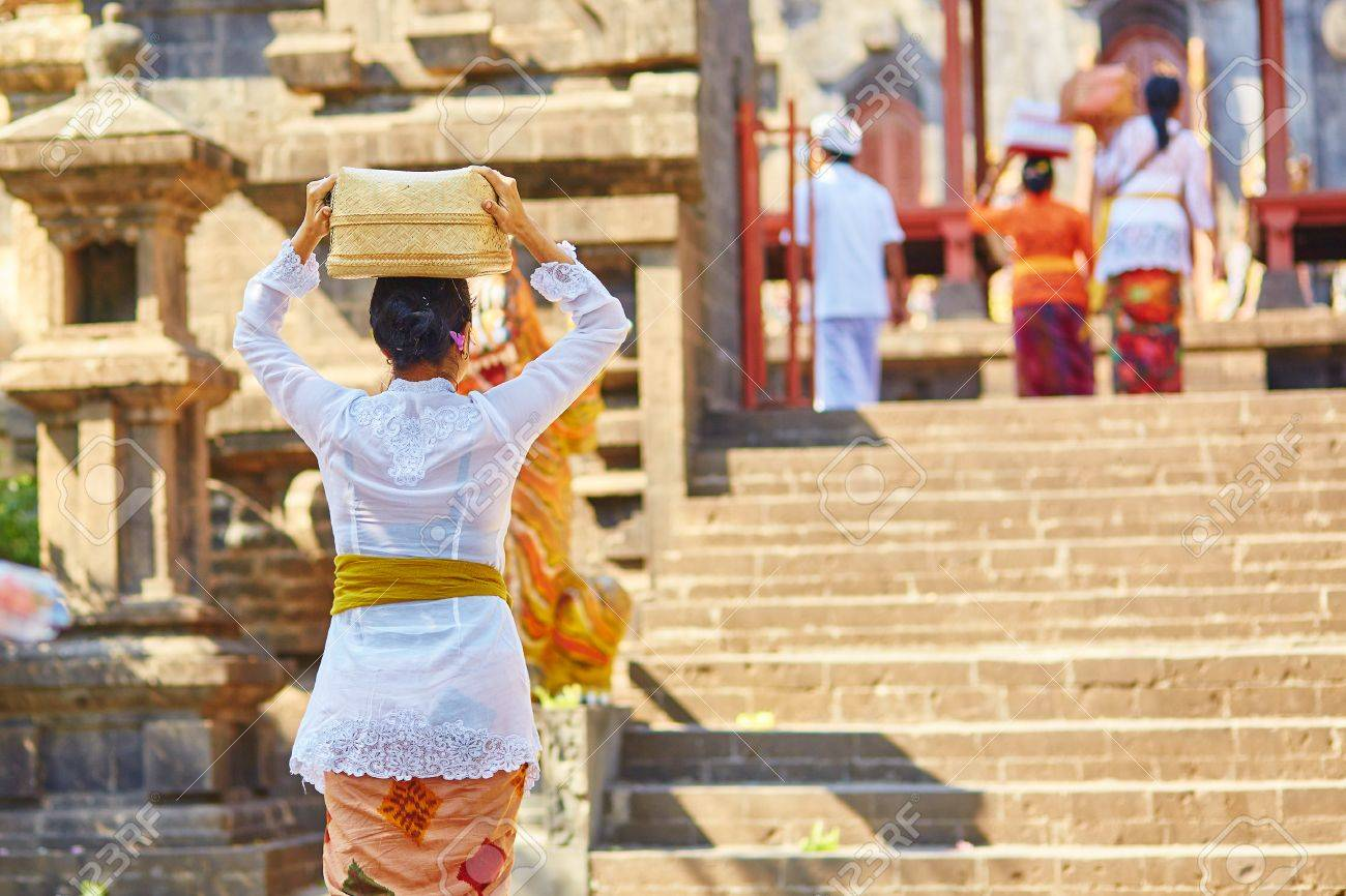 Balinese People Going To The Temple With Offerings