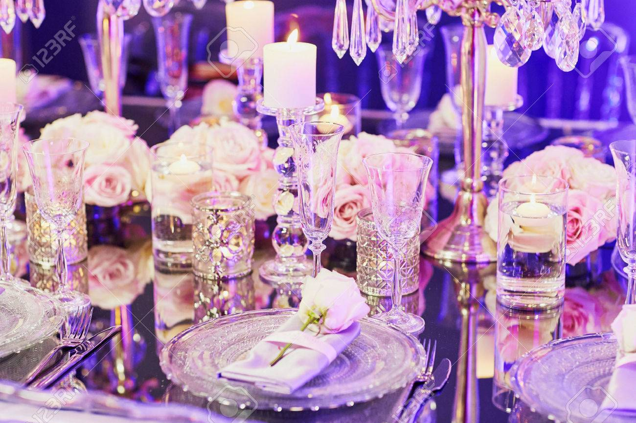 Beautiful Table Set With Candles And Flowers For A Festive Event ...