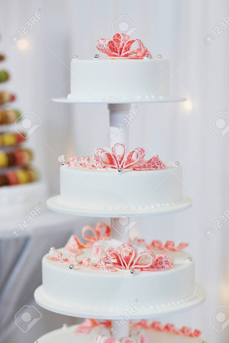 White wedding cake decorated with pink sugar flowers stock photo stock photo white wedding cake decorated with pink sugar flowers mightylinksfo