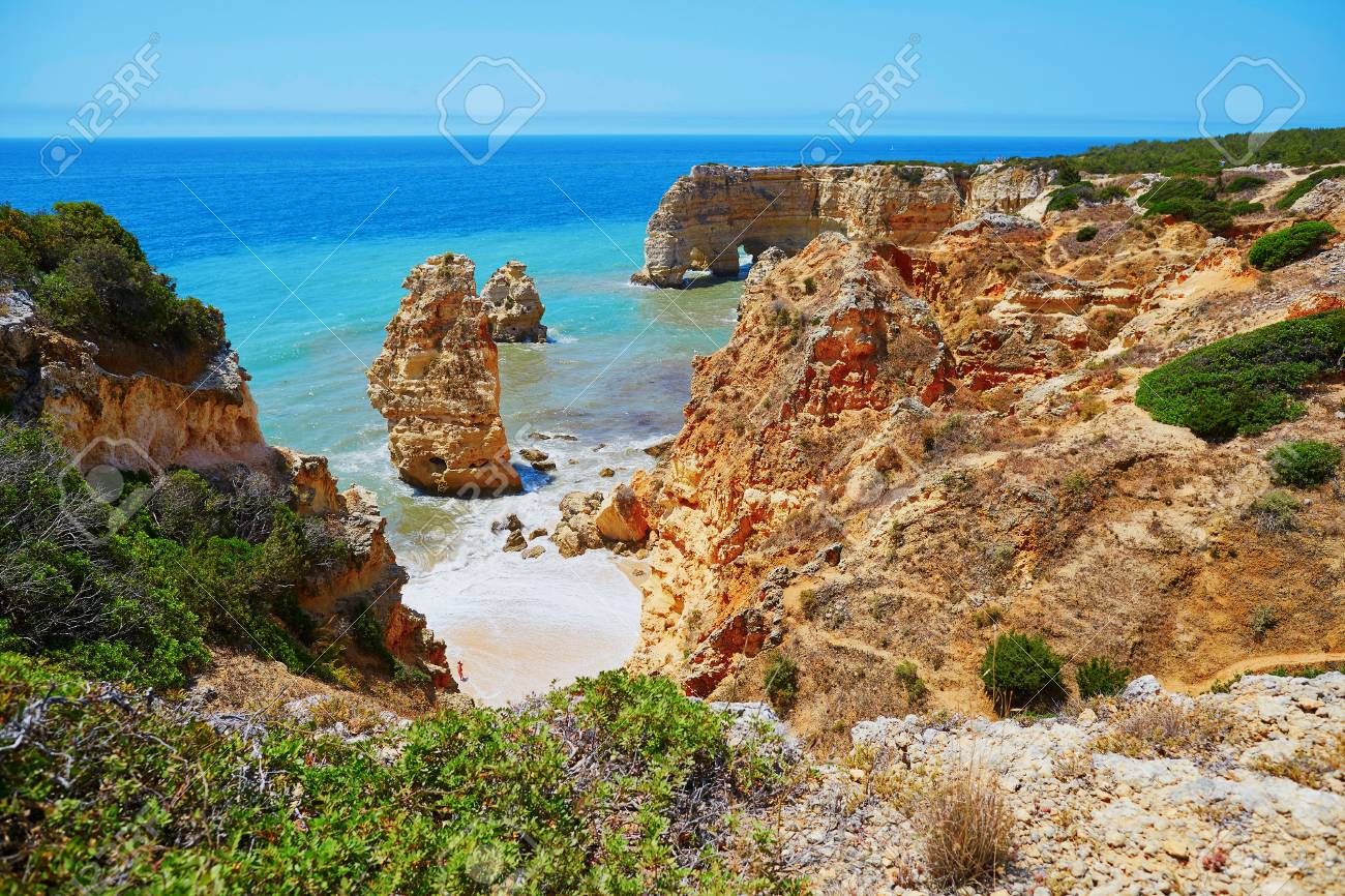 Scenic Landscape With Ocean Sand Beaches And Rocks In Algarve Portugal Stock Photo