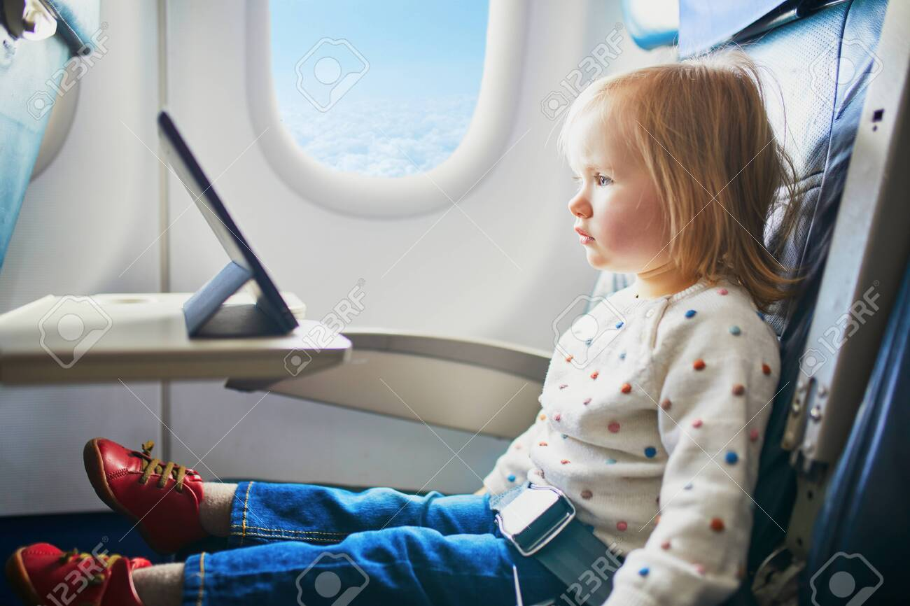 Adorable Little Toddler Girl Traveling By Plane Small Child Stock Photo Picture And Royalty Free Image Image 140639133