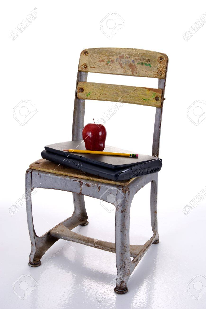 https://previews.123rf.com/images/eponaleah/eponaleah1109/eponaleah110900007/10473860-old-fashioned-school-chair-holding-a-laptop-computer-with-a-red-apple-and-pencil-against-a-white-bac.jpg