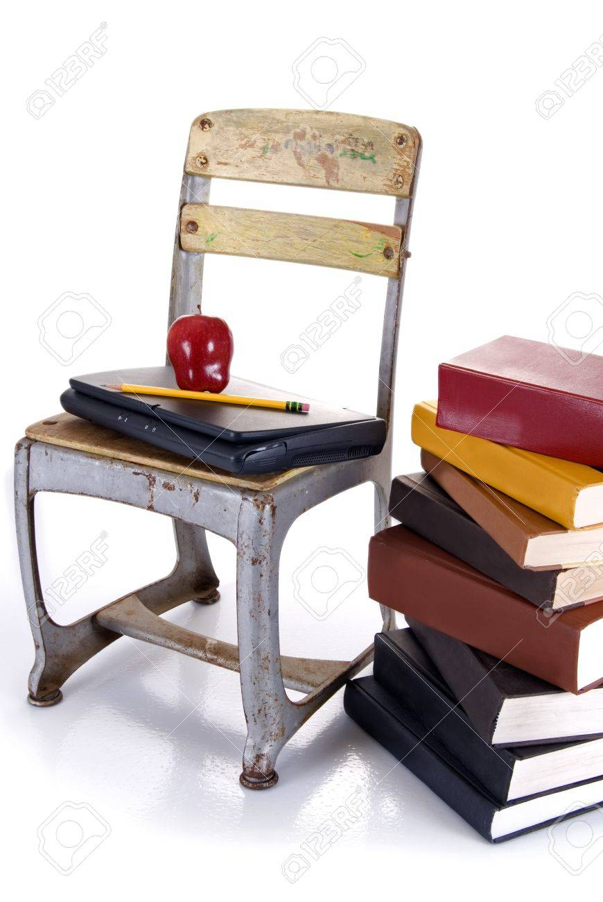 An Old School Chair Holding A Laptap With An Apple And Pencil Ontop Beside  A Stack