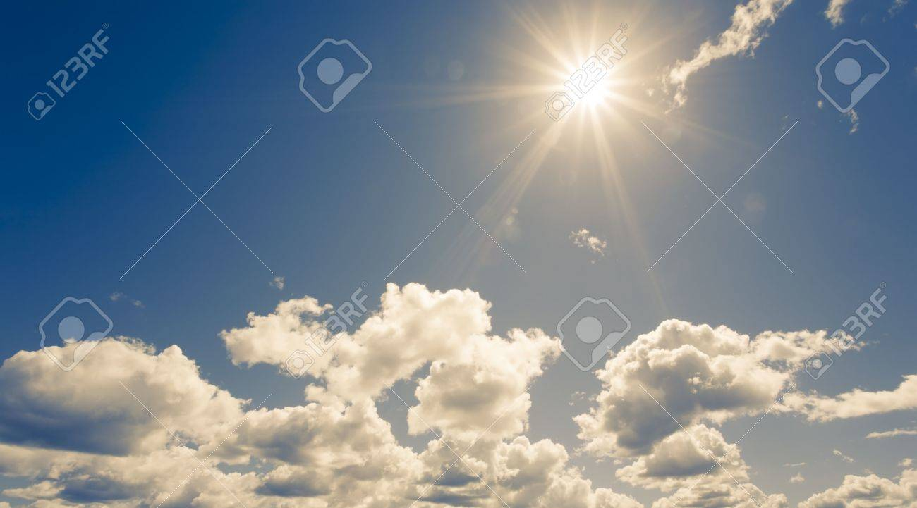 bright sun on blue sky with fluffy clouds Stock Photo - 6057078