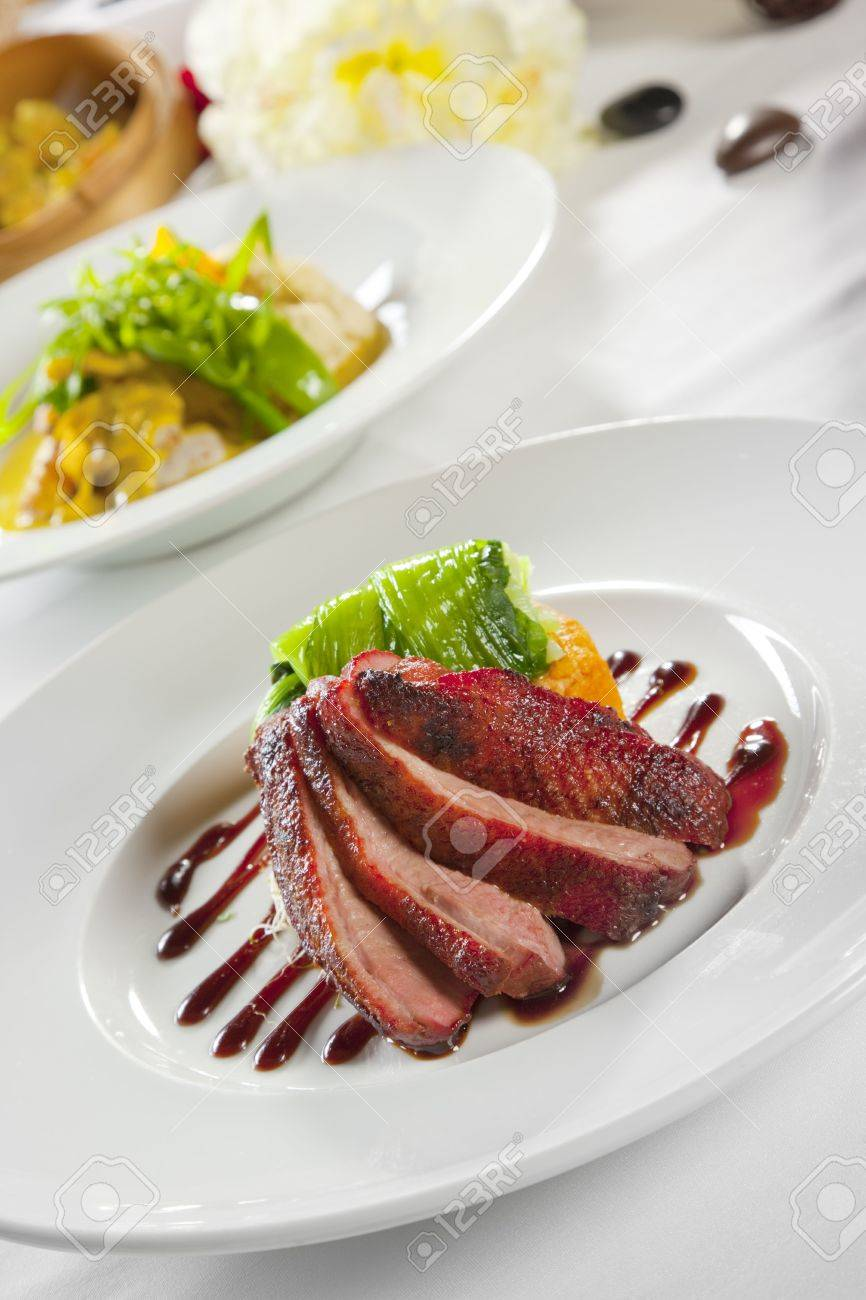 Oven Crisp Duck Breast Marinated In A Peking Duck Style Sauce On A Tian Of Polenta