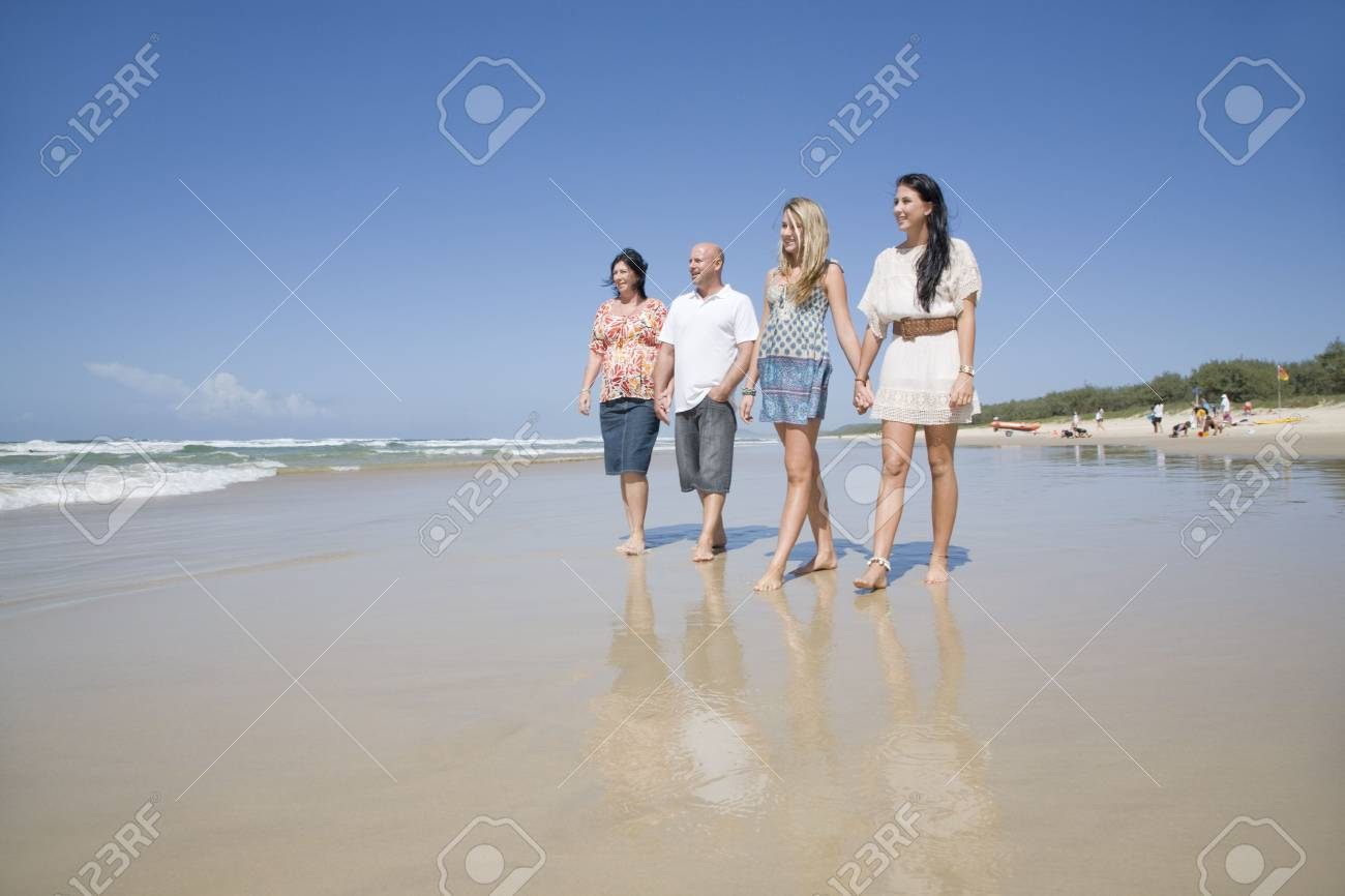 family walking on beach holding hands Stock Photo - 6151895