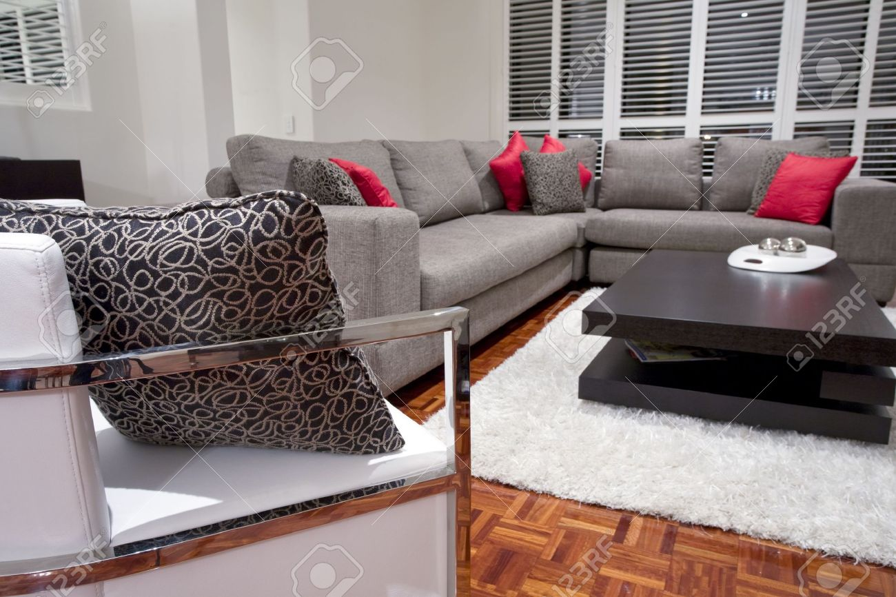 modern living room interior with charcoal sofa and chocolate brown coffee table Stock Photo - 6151919
