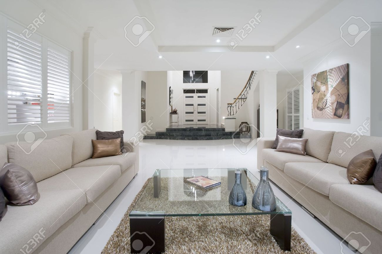 Luxurious Living Room With Grand Entrance In The Background Stock ...