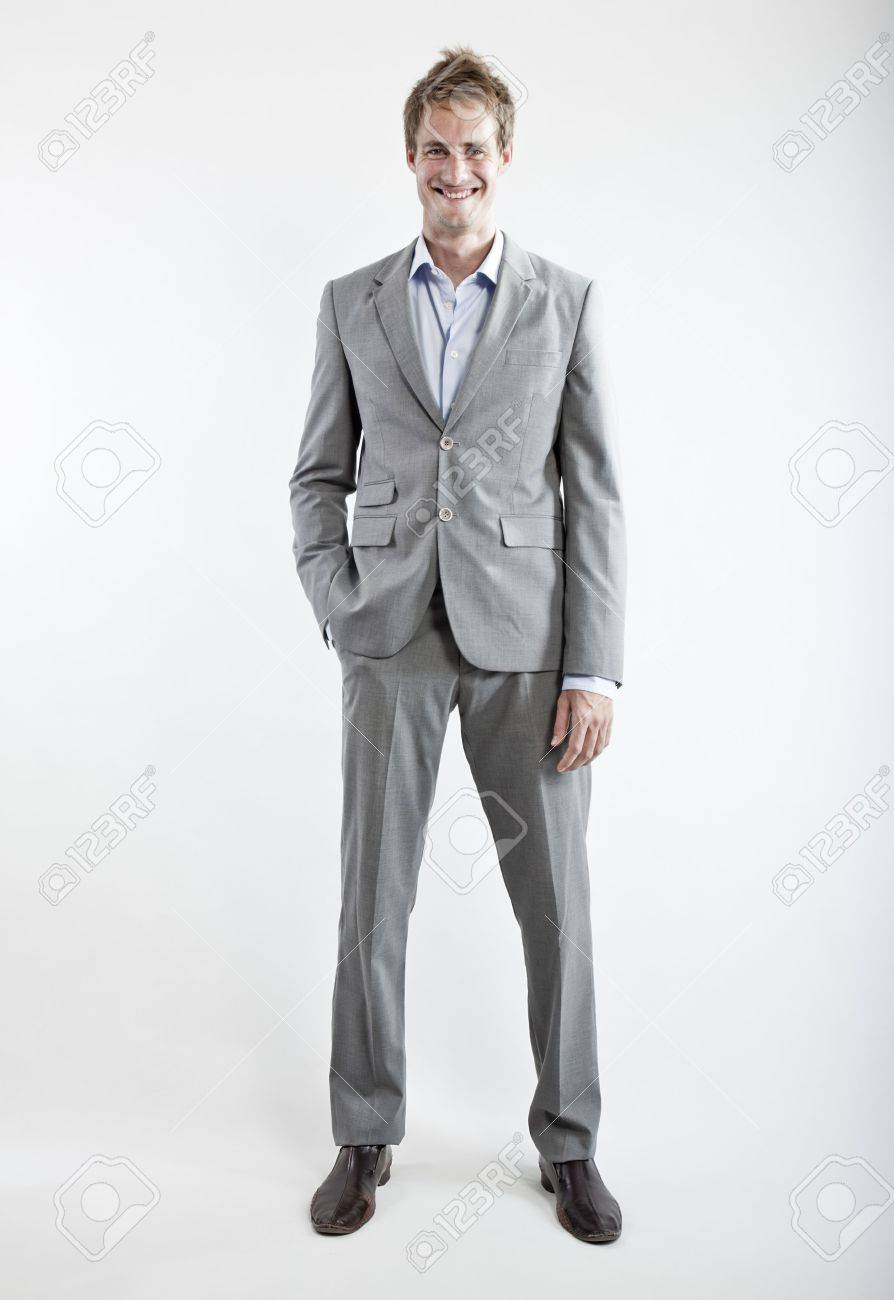business man in grey suit on white background in studio Stock Photo - 6550362