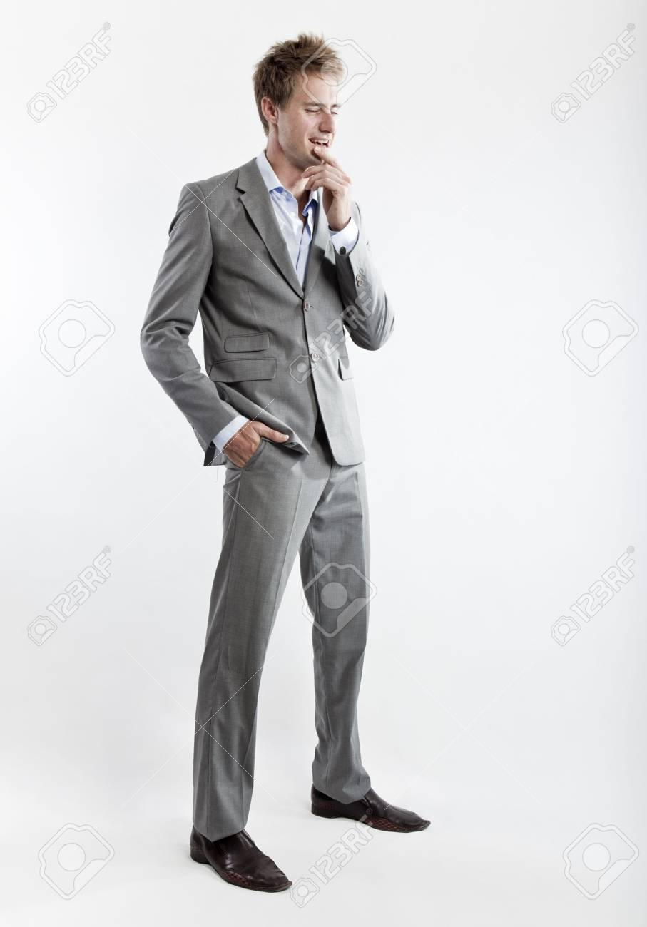 business man in grey suit on white background in studio Stock Photo - 6550355