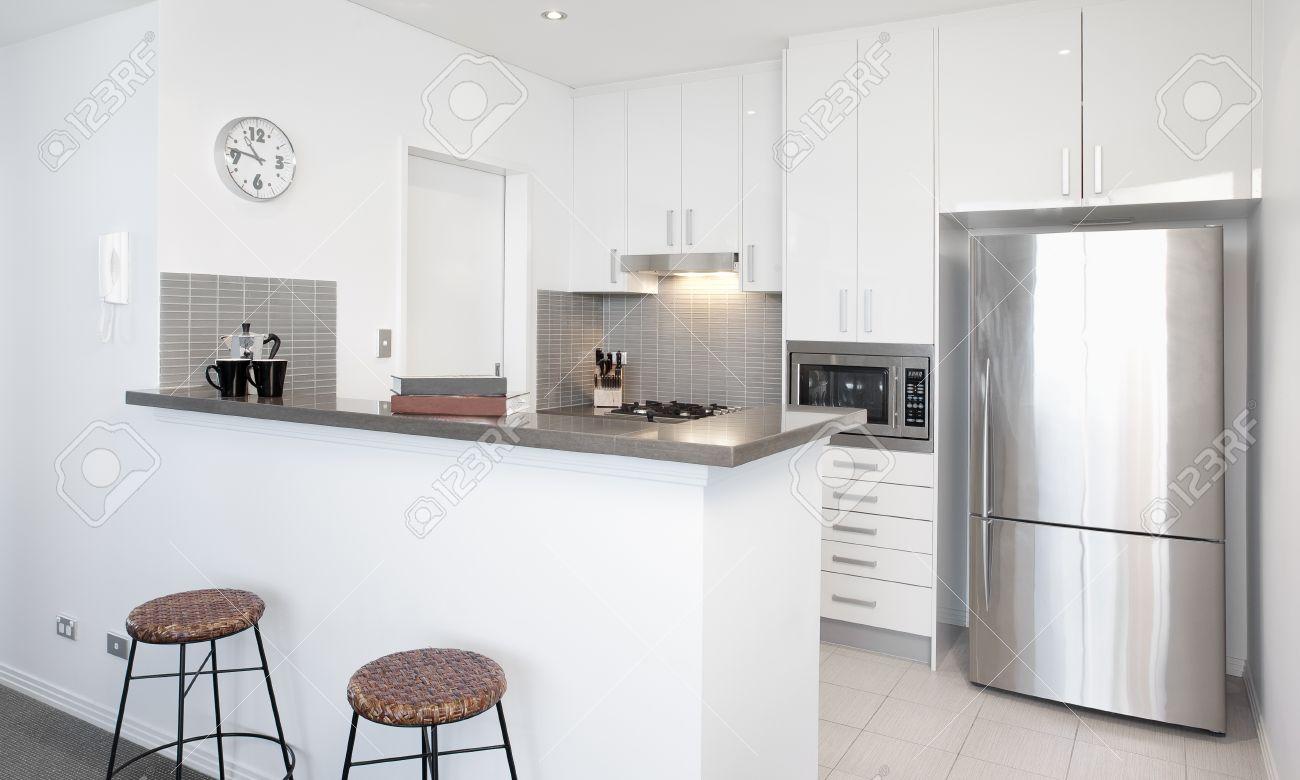 Uncategorized White Kitchen Stainless Steel Appliances modern white kitchen in apartment with polished stainless steel appliances stock photo 11800523