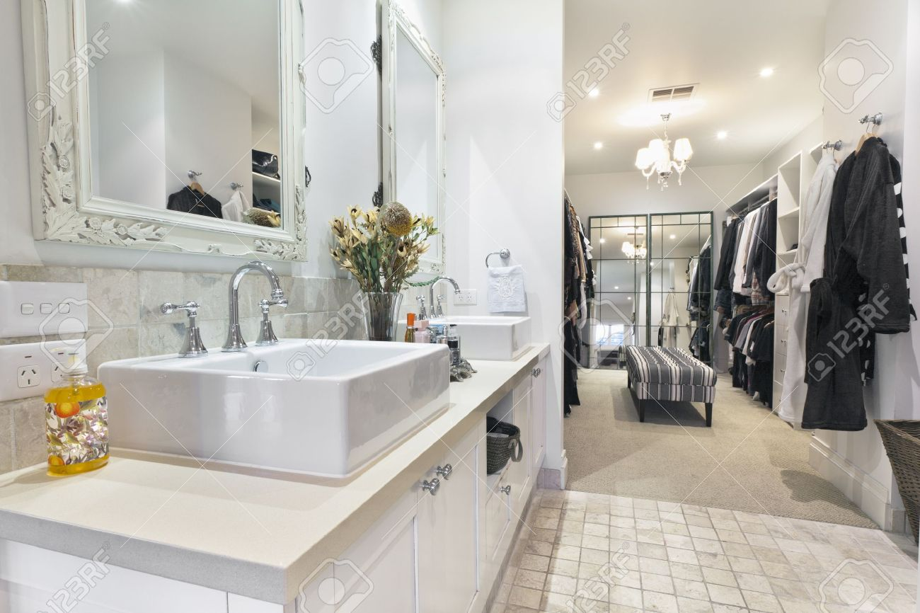 Stylish master bathroom with twin sinks and spacious walk in robe Stock Photo - 11800565