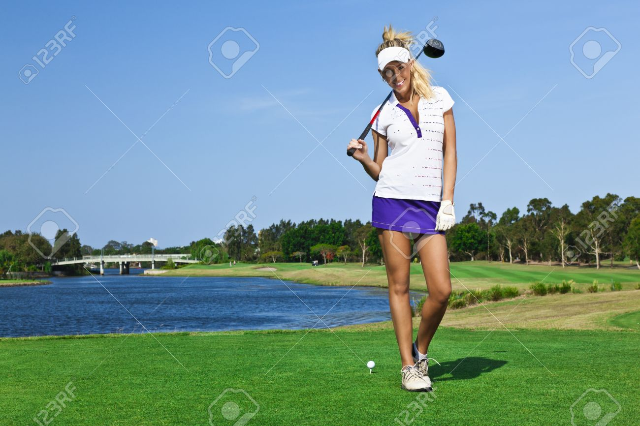 Attractive golfer girl on golf course with driver Stock Photo - 13909611
