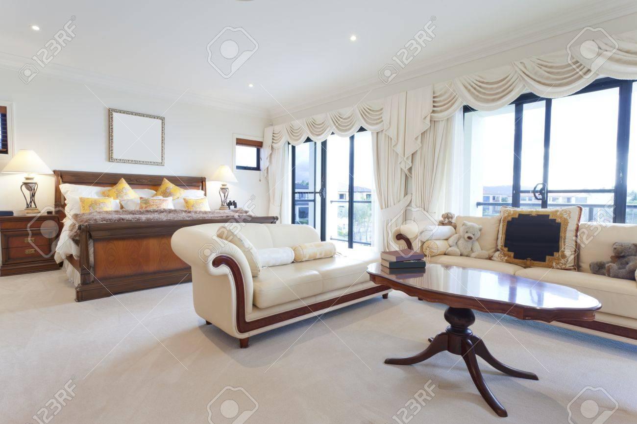 Spacious master bedroom in luxury house overlooking