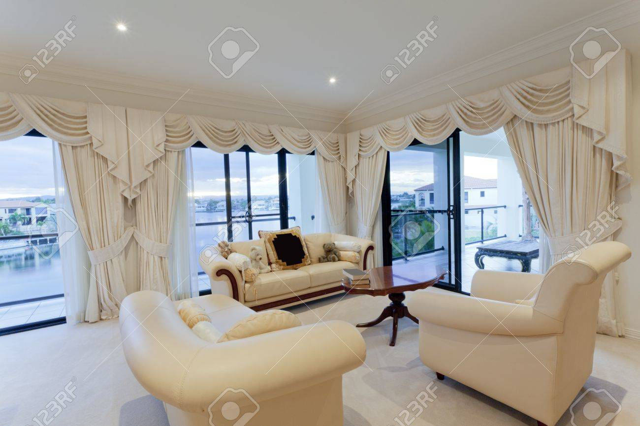 stylish living room with view of waterfront houses stock photo