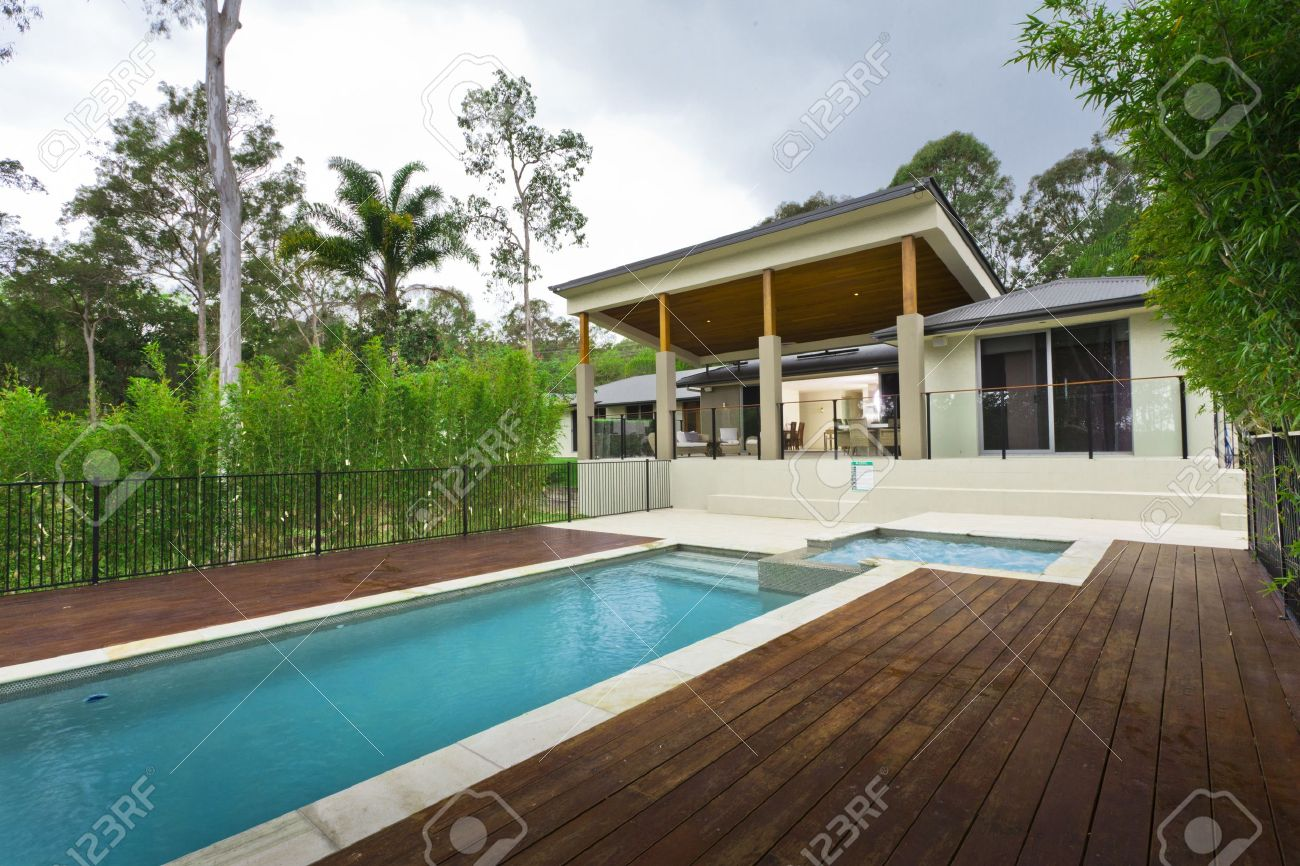modern backyard with swimming pool and outdoor entertaining area