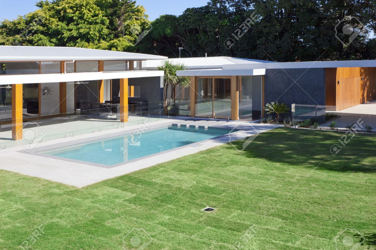 modern backyard with swimming pool in australian mansion stock