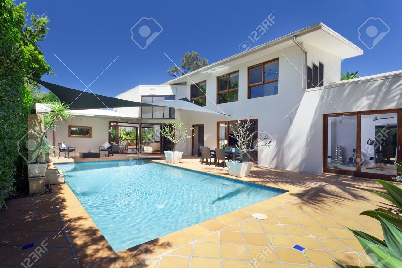 modern backyard with swimming pool in australian mansion stock photo 15616648