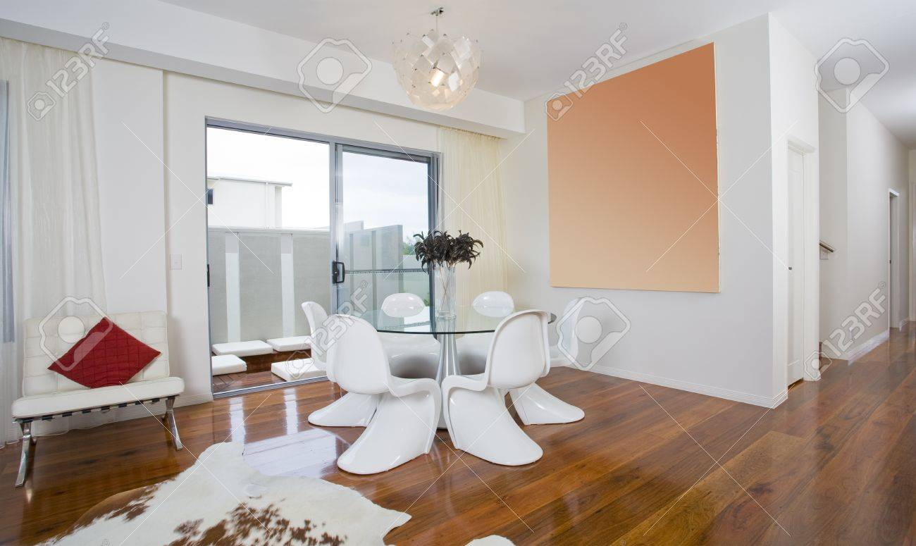 Modern Dining Area With Round Table And Funky Chairs Stock Photo ...