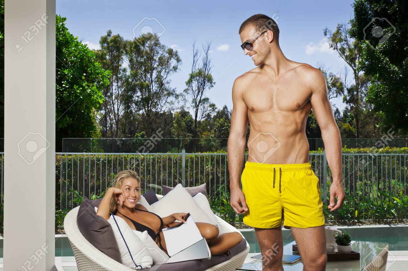 Attractive young couple in backyard patio Stock Photo - 17686859