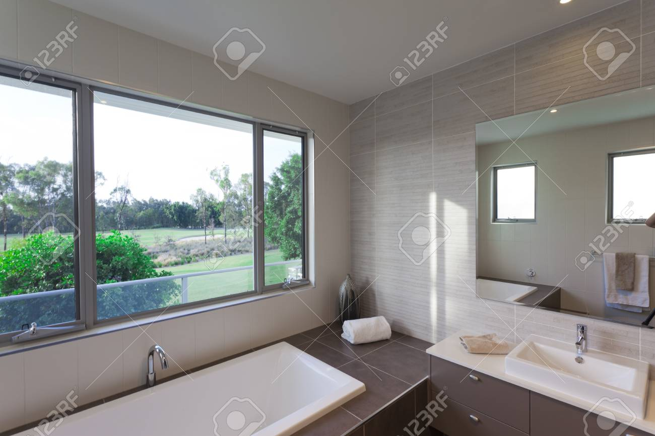 Modern bathroom over looking a golf course Stock Photo - 17686810