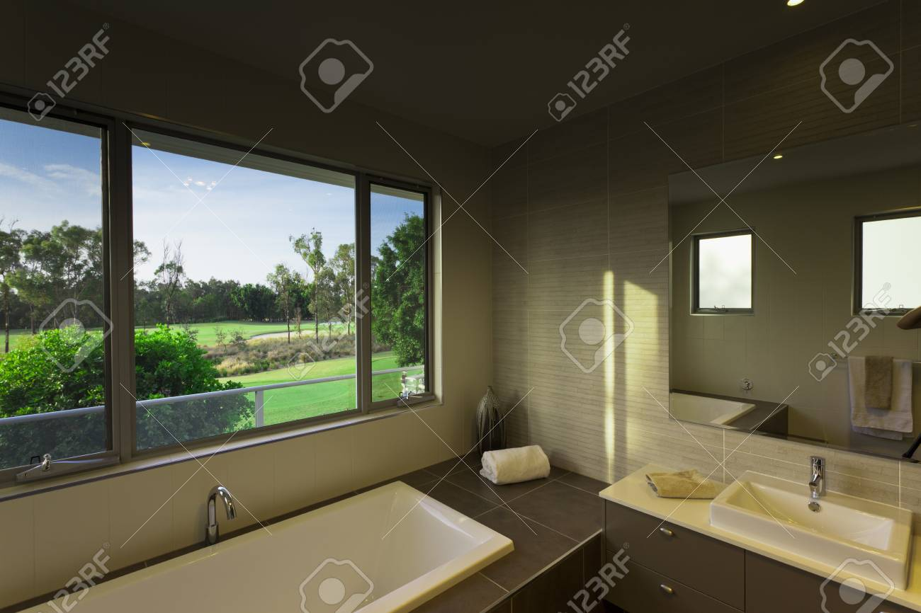 Modern bathroom over looking a golf course Stock Photo - 17686817