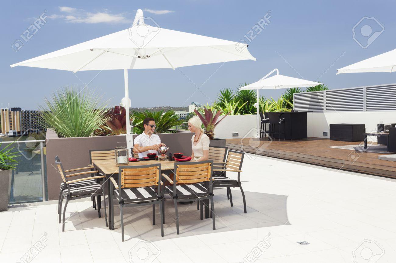 Young couple enjoying breakfast on modern balcony Stock Photo - 18573566