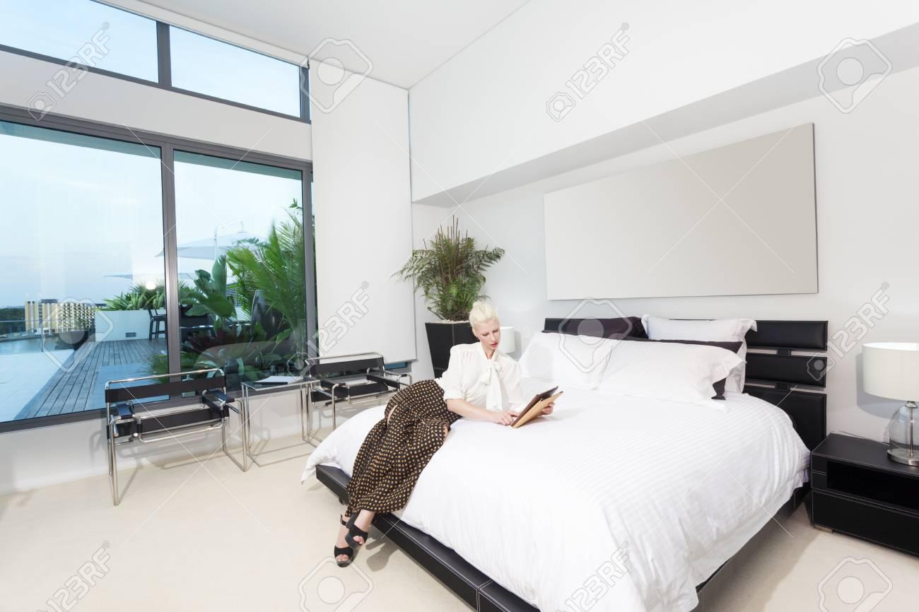 Attractive woman in modern bedroom Stock Photo - 18573145