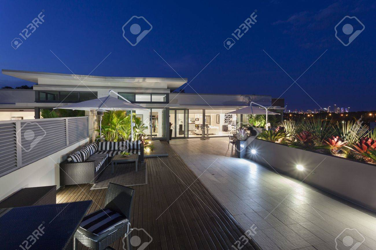 modern balcony at sunset in luxury penthouse stock photo picture
