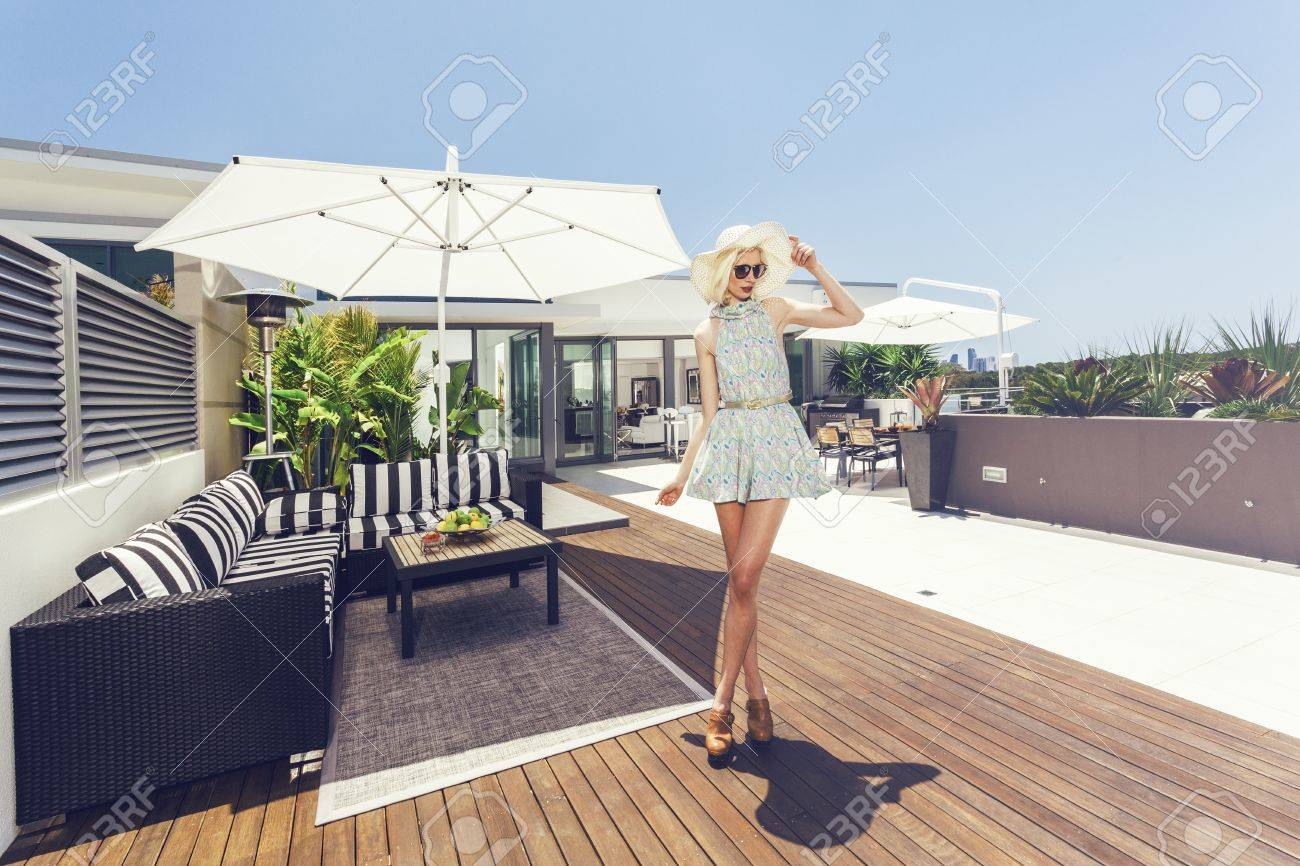 Attractive woman on luxurious penthouse balcony Stock Photo - 18937021