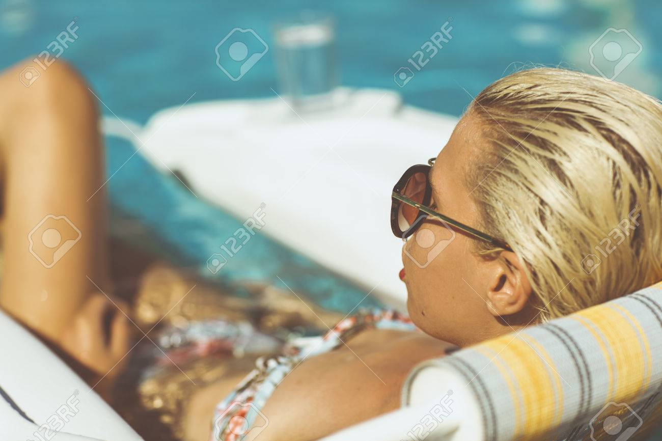 Young woman relaxing in pool on a hot summers day Stock Photo - 23066987
